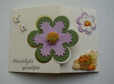 Witte kaart met groene spirelli bloem